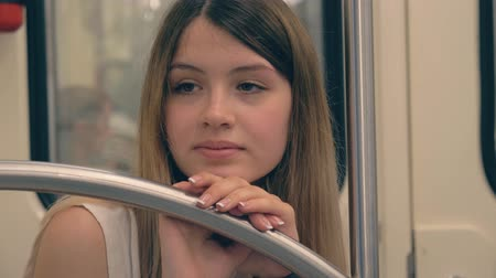 sentido : Sad Young Caucasian Woman Leaned Her Head And Hand On The Railing In The Subway