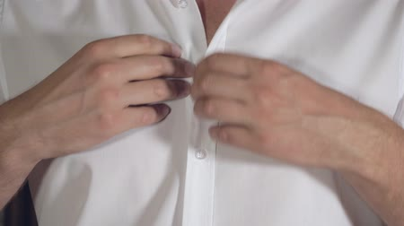 buttoning : Man Hand Fastens A Button On A White Shirt