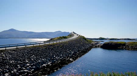 mais : Cars Drive To Storseisundet Bridge In Atlantic Road Norway At Sunny Day