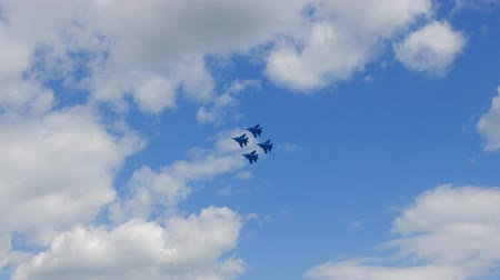 squadron : Military Fighter Jets Flying In Rhombus Next To Each Other In Aerobatics In Sky