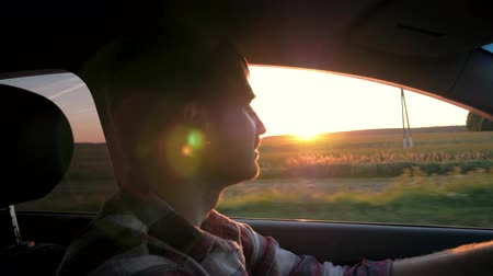 Man Drive In The Car On The Background Of The Sunset Stock mozgókép