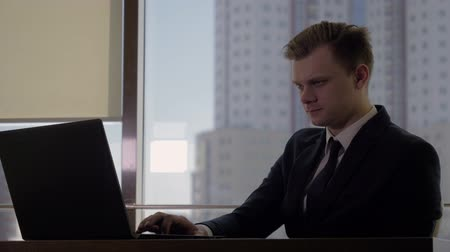 Man Top Manager In A Business Suit At His Workplace At The Computer In Office Wideo
