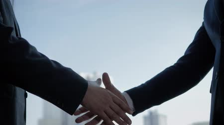 job transfer : Businessmen Passed Documents Of Contract And Shake Hands At Window In The Office Stock Footage