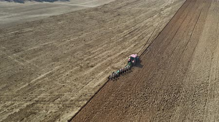 tırmık : Agricultural Tractor With Plow Plowing The Field Before Planting Aerial View
