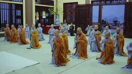boudha : Hanoi, Vietnam - March 8, 2015: Monks Pray In Temple Stock Footage