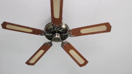 wooden ceiling fan spinning