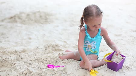 little : Beautiful little girl playing on tropical beach