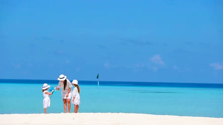 vacation : Beautiful tropical beach landscape with family in white enjoying summer vacation