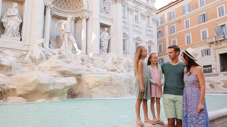 triton : Family near Fontana di Trevi, Rome, Italy. Happy parents and kids enjoy italian vacation holiday in Europe. Stock Footage