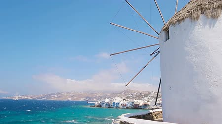 Киклады : Famous view of traditional greek windmills on Mykonos island at sunrise, Cyclades, Greece Стоковые видеозаписи