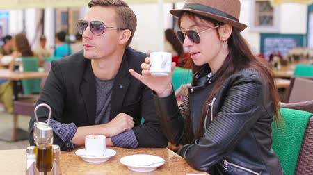 coffee time : Restaurant tourists couple eating at outdoor cafe. Young woman and man enjoy time outside ay warm summer day Stock Footage