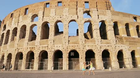Колизей : Adorable girls having fun in front of Colosseum in Rome, Italy.