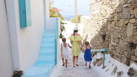 távozás : Family vacation in Europe. Mother and little girl in european vacation in greek town