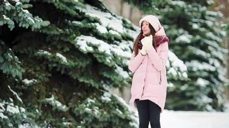 mittens : Beautiful girl at snow weather outdoors on winter day Stock Footage