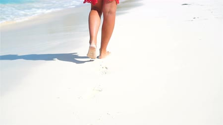protects : Female legs running along the white beach in shallow water. Concept of beach vacation and barefoot. SLOW MOTION.