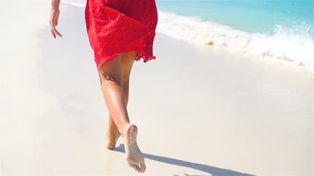 protects : Closeup legs running along the white beach in shallow water. Concept of beach vacation and barefoot. SLOW MOTION.