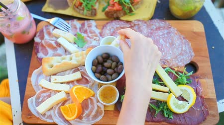 fresh cheeses : Tasty italian food. Fresh bruschettes, cheeses and meat on the board in outdoor cafe with amazing view in Manarola, Italy