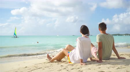 palmtree : Young couple on tropical beach with white sand and turquoise ocean water at Antigua island in Caribbean