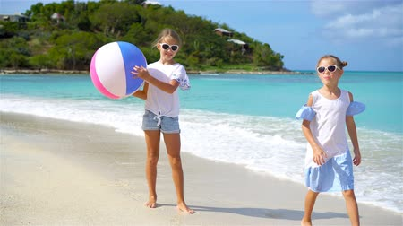 beach ball : Little adorable girls playing with ball on the beach.