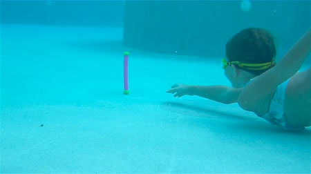submerge : Adorable little girl in the swimming pool underwater