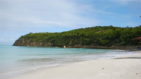 perfect weather : Idyllic tropical Carlisle bay beach with white sand, turquoise ocean water and blue sky at Antigua island