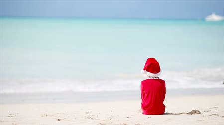 turkuaz : Little adorable girl in Christmas hat on white beach during Xmas vacation