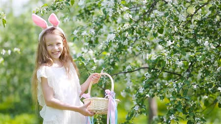 rabbit ears : Adorable little girl in blooming apple garden on beautiful spring day