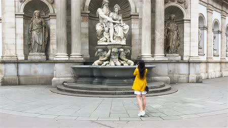 mozart : Woman walking in city. Young attractive tourist outdoors in european city Stock Footage