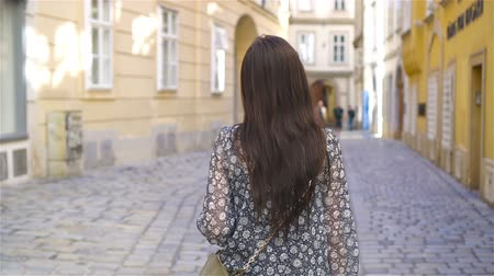 mozart : Woman walking in city. Young attractive tourist outdoors in italian city