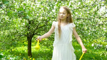 szag : Adorable little girl in blooming apple garden on beautiful spring day