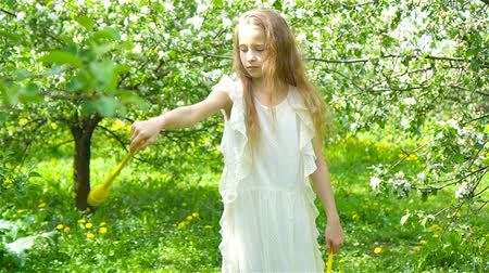 apple tree : Adorable little girl in blooming apple garden on beautiful spring day