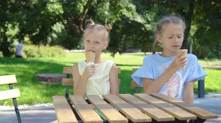 vacations cones : Little girls eating ice-cream at summer