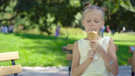 vacations cones : Little girl eating ice-cream  at summer
