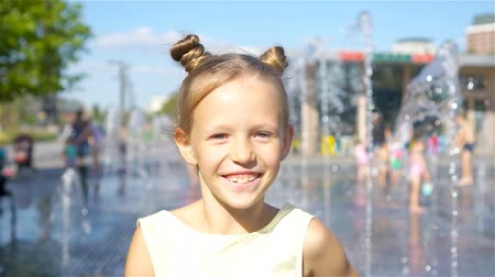 ferahlatıcı : Little adorable girl have fun in street fountain at hot sunny day