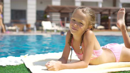 soczi : Beautiful little girl having fun near an outdoor pool