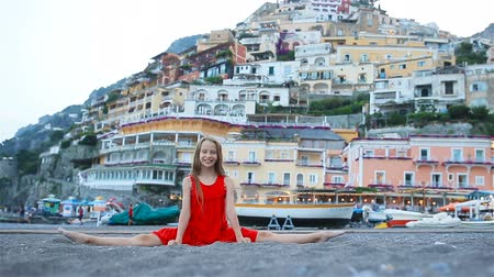 amalfi : Adorable little girl on warm and sunny summer day in Positano town in Italy