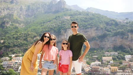 positano : Young family in Positano village on the background, Amalfi Coast, Italy Stock Footage