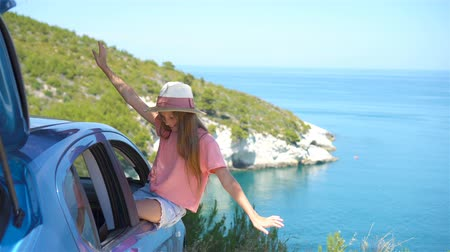 sisters : Little girl on vacation travel by car background beautiful landscape