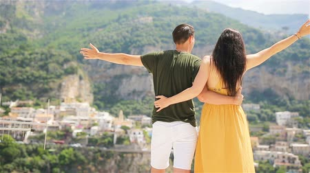 positano : Summer holiday in Italy. Young couple in Positano village on the background, Amalfi Coast, Italy Stock Footage