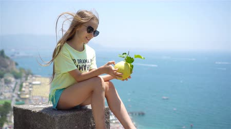 amalfi : Big yellow lemon in hand in background of mediterranean sea and sky. Stock Footage