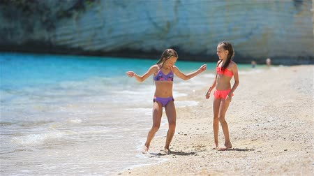 strand : Little girls having fun at tropical beach during summer vacation