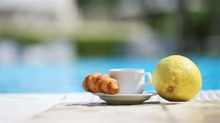 mandarina : Delicious breakfast lemon, coffee, croissant by the pool Archivo de Video