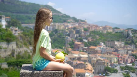 amalfi coast : Big yellow lemon in hand in background of mediterranean sea and sky. Stock Footage