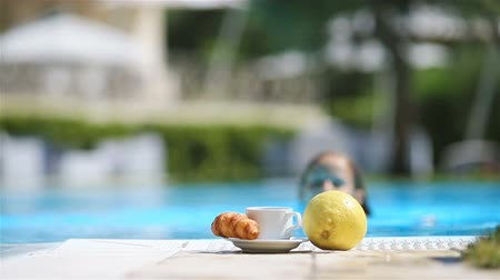 bagietka : Delicious breakfast lemon, coffee, croissant by the pool Wideo