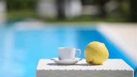 Delicious breakfast lemon, coffee, croissant by the pool 動画素材