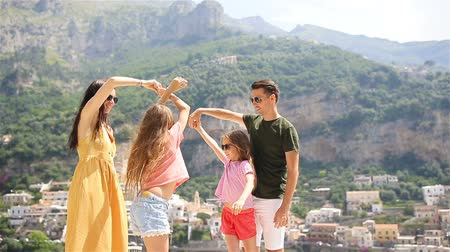 Young family in Positano village on the background, Amalfi Coast, Italy 動画素材