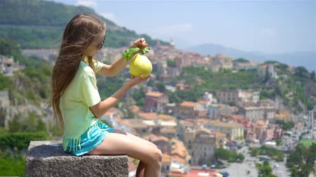 Big yellow lemon in hand in background of mediterranean sea and sky. Wideo