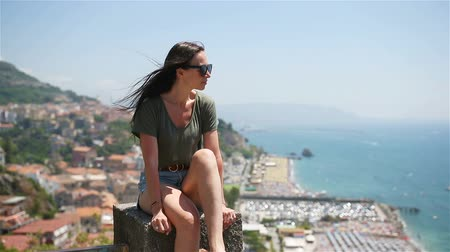 Young woman in background of mediterranean sea and sky. Wideo