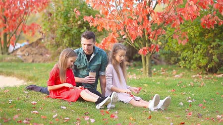 outonal : Family of dad and kids on beautiful autumn day in the park Stock Footage