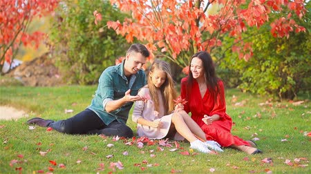 wrzesień : Portrait of happy family of four in autumn Wideo